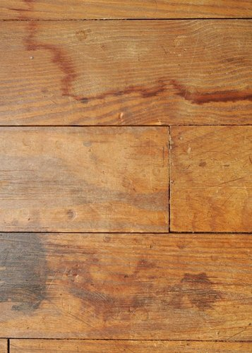 Scratched and stained hardwood floor