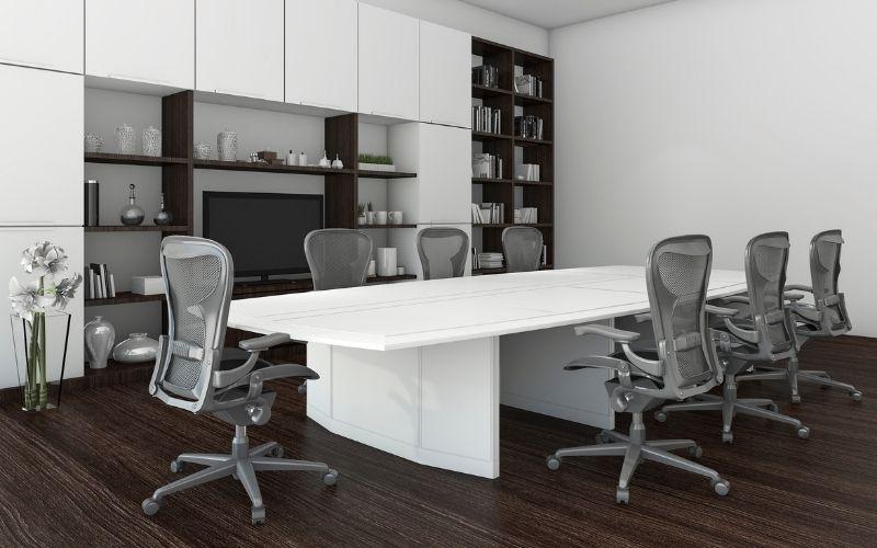 Dark wood floor office with metal chairs