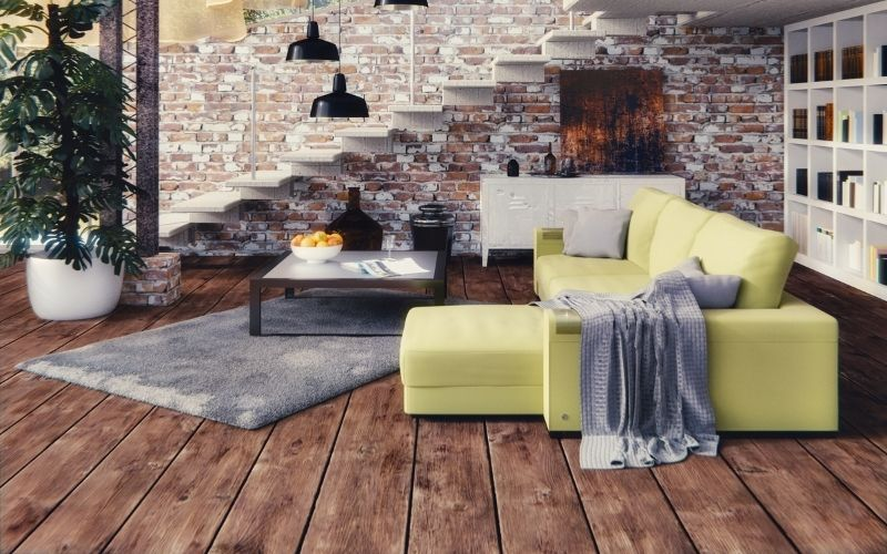 Dark wood floor with bright green couch and pops of white